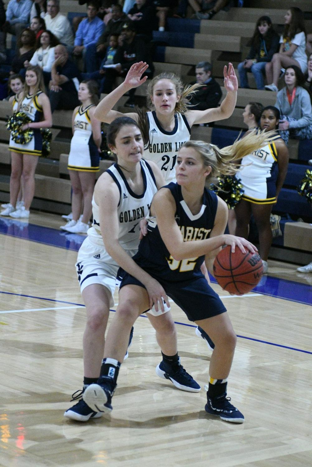 Sophomores Anna Elizabeth Whitlark and Lindsey Broadway defend a Marist player at a home game in December. The team won  41-32, earning their first victory of the season.