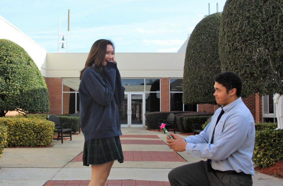Junior John McKimmy declares his love for senior Ella Cate Hungeling with a rose on Valentine's Day.