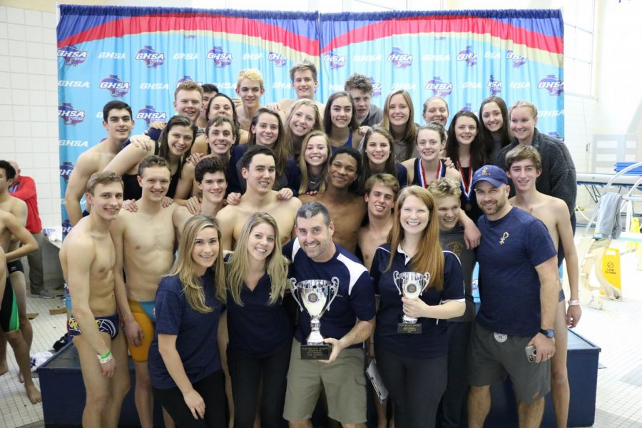The+boys%27+and+girls%27+teams+show+off+their+1st+and+2nd+place+trophies+at+the+state+meet+on+Saturday%2C+February+9.