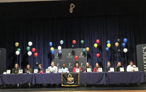 Senior athletes sign to play in college