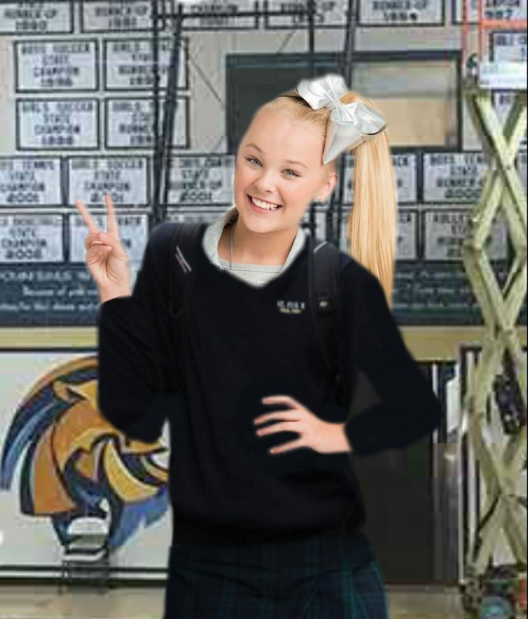 JoJo Siwa rocks her new school uniform while visiting St. Pius X.