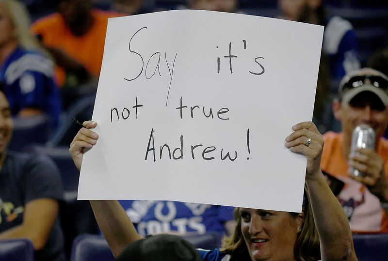 A+Colts+fan+hold+up+a+sign+expressing+her+sadness++after+learning+that+star+quarterback+Andrew+Luck+was+suddenly+retiring.