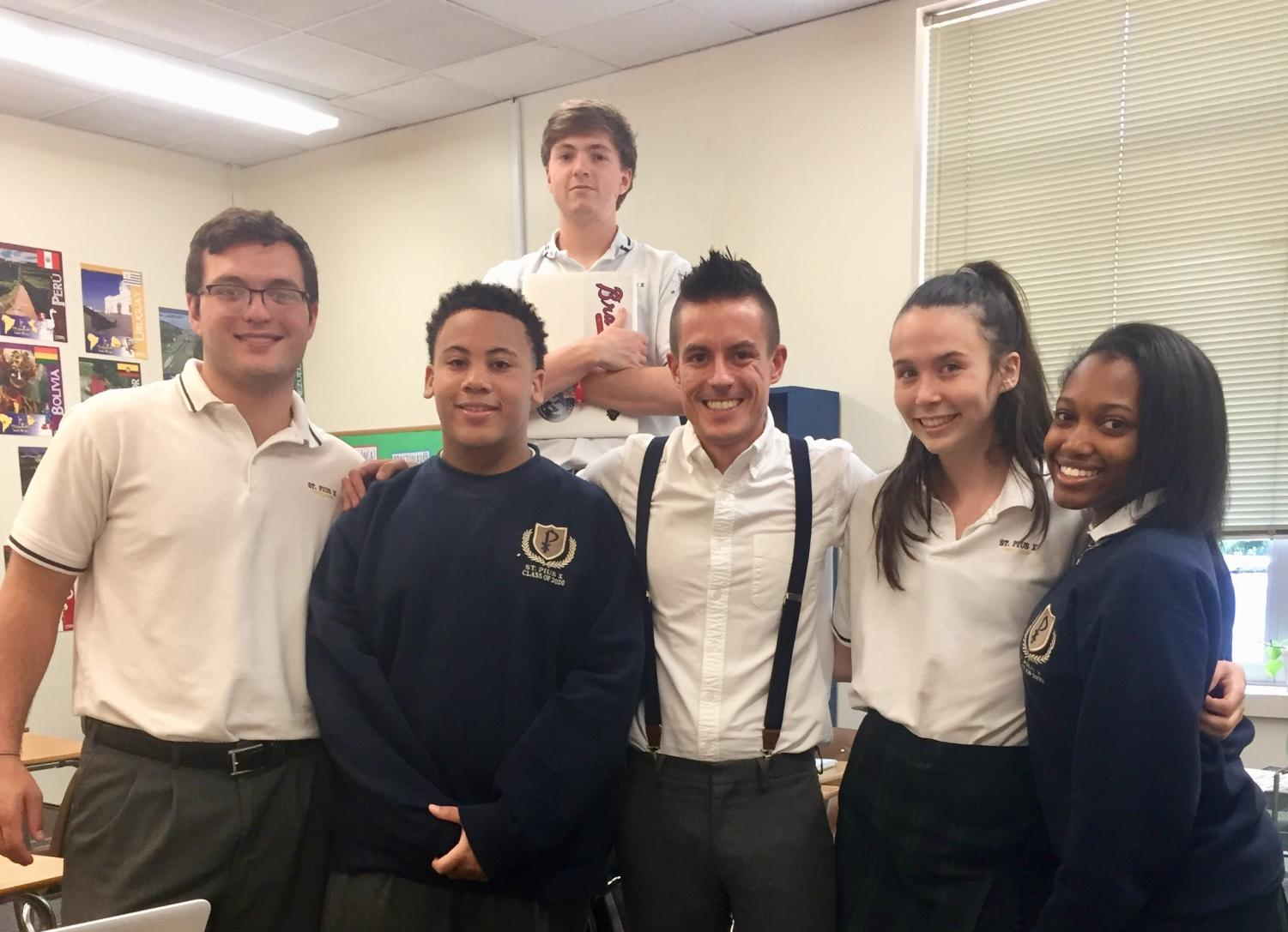 World Languages teacher Mr. Brennan Hamilton takes a picture with seniors from his Spanish IV class (L to R: Vincent  Thomas, Josh Portis, Tommy Fry, Mr. Hamilton, Kayla Carter and Ashley Myles. Mr. Hamilton is one of five new World Languages teachers this school year.
