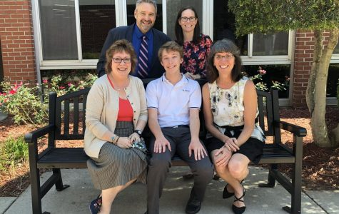 Senior Witt Hollensbe takes a picture with with his 9th, 10th, and 11th grade English teachers and his newspaper adviser. Hollensbe recently was awarded a Certificate of Superior Writing from the National Council of Teachers of English (NCTE), which recognizes the best writers in the nation.