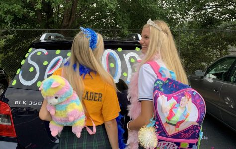 Participating in an annual senior tradition, seniors Ellie Van Arkel and Parker Timmons show off their fun backpacks on the first day of school. Timmons and her friends plan on donating their backpacks to Totes 2 Tots.