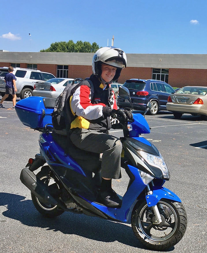 Sophomore Hunter Minne drives home after school on his moped named Blueberry Jr.