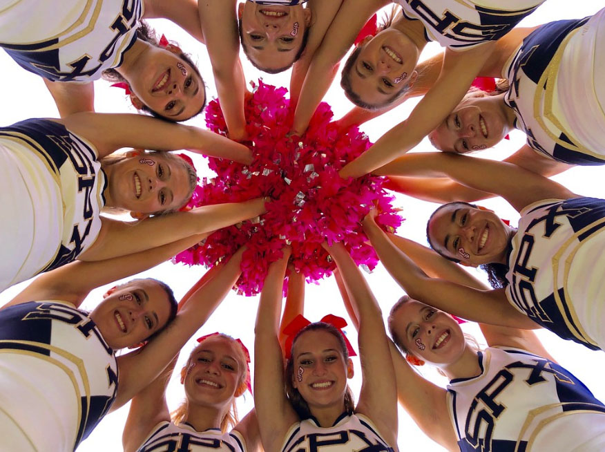 The varsity football cheerleaders gather together before the annual Pink Out game against Oconee County on Friday, October 11.