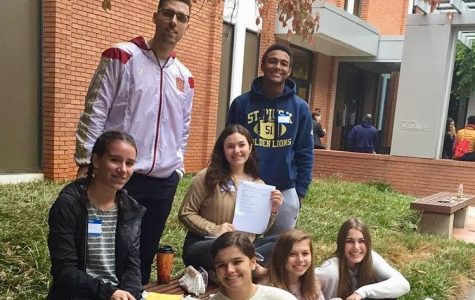 Spanish teacher Mr. Adi Brkic and a group of St. Pius X students get in some final preparations for the poetry declamation contest at Clemson University on Saturday, October 19. Senior Anna Buyarski (Latin IV) placed third, and junior Katie Fish (Latin III) placed second.