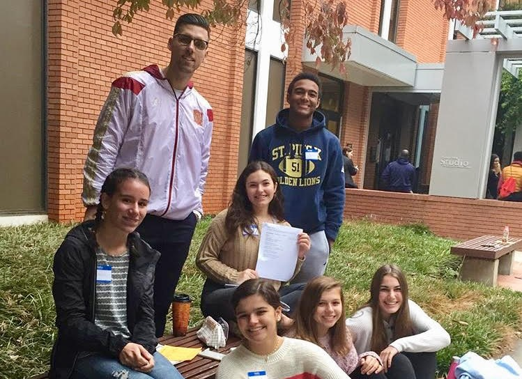 Spanish+teacher+Mr.+Adi+Brkic+and+a+group+of+St.+Pius+X+students+get+in+some+final+preparations+for+the+poetry+declamation+contest+at+Clemson+University+on+Saturday%2C+October+19.+Senior+Anna+Buyarski+%28Latin+IV%29+placed+third%2C+and+junior+Katie+Fish+%28Latin+III%29+placed+second.