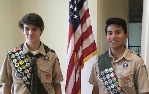 Senior Joe Williams (right) proudly stands next to a friend at their Eagle Scout ceremony last year. Williams is one of several St. Pius students who have earned the Eagle Scout rank, the highest level a scout can achieve.