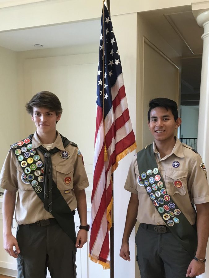 Senior+Joe+Williams+%28right%29+proudly+stands+next+to+a+friend+at+their+Eagle+Scout+ceremony+last+year.+Williams+is+one+of+several+St.+Pius+students+who+have+earned+the+Eagle+Scout+rank%2C+the+highest+level+a+scout+can+achieve.
