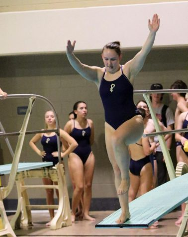 Freshman Julia Herring prepares for a dive in a meet against Marist. Herring won the 4A-5A state title last weekend.