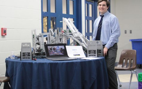 Sophomore Will Montello works at the robotics table during Open House in November. The program began five years ago, and this year's RoboLions are having their most successful season ever.