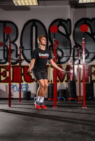 Senior Grant Sasser jumps rope at his Crossfit gym. What started out as a convenient way to stay in shape has now evolved into a passion for Sasser.