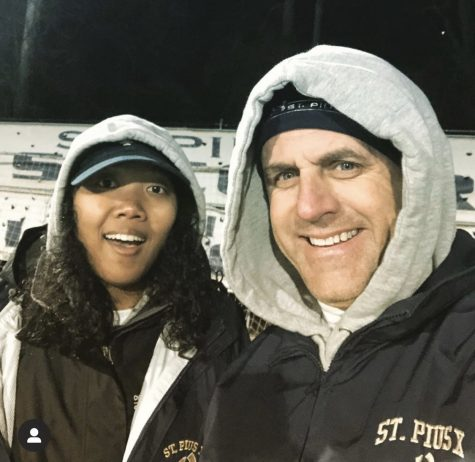 Laschonda Pituk works with head athletic trainer Gary Schmitt on the sidelines of a soccer game earlier this year. Pituk joined the staff in January.