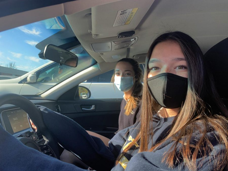 Sophomore Elizabeth Nark sits in the passenger seat of junior Elizabeth Hong's car. While some students can't wait to get behind the wheel, Nark makes a strong argument for why being driven to and from school is the better option.