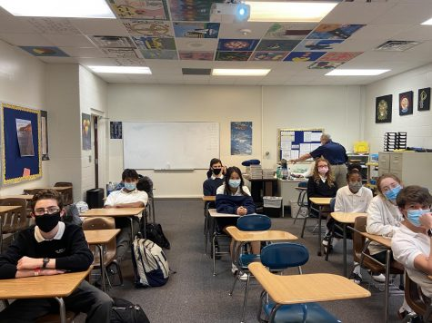 Students in Advisory 50 prepare to discuss the harmful side effects of social media and the Internet. Replacing homeroom, Advisories include students from all grades and help foster community within our school.