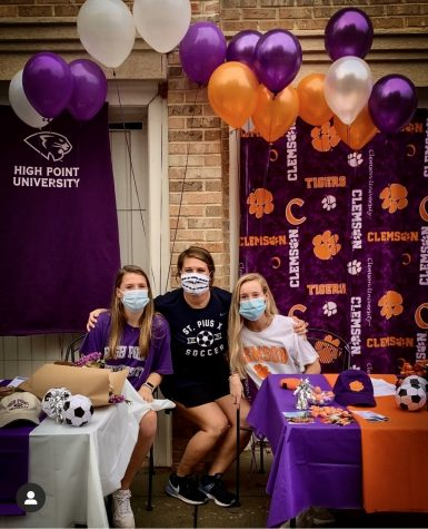 Senior Isabelle Lee (High Point University) and Renee Lyles (Clemson University) celebrate their signing day on November 11 with head soccer coach Sara Schmitt.