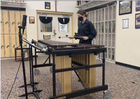 Junior Lucy Vrazel practices percussion for upcoming GHP interview.
