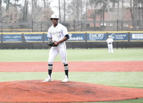 Senior Agyei Quinichett pitches against Arabia Mountain at a home game in February. Quinichett and his teammates face Eastside Wednesday, April 28 in the first round of the state playoffs.