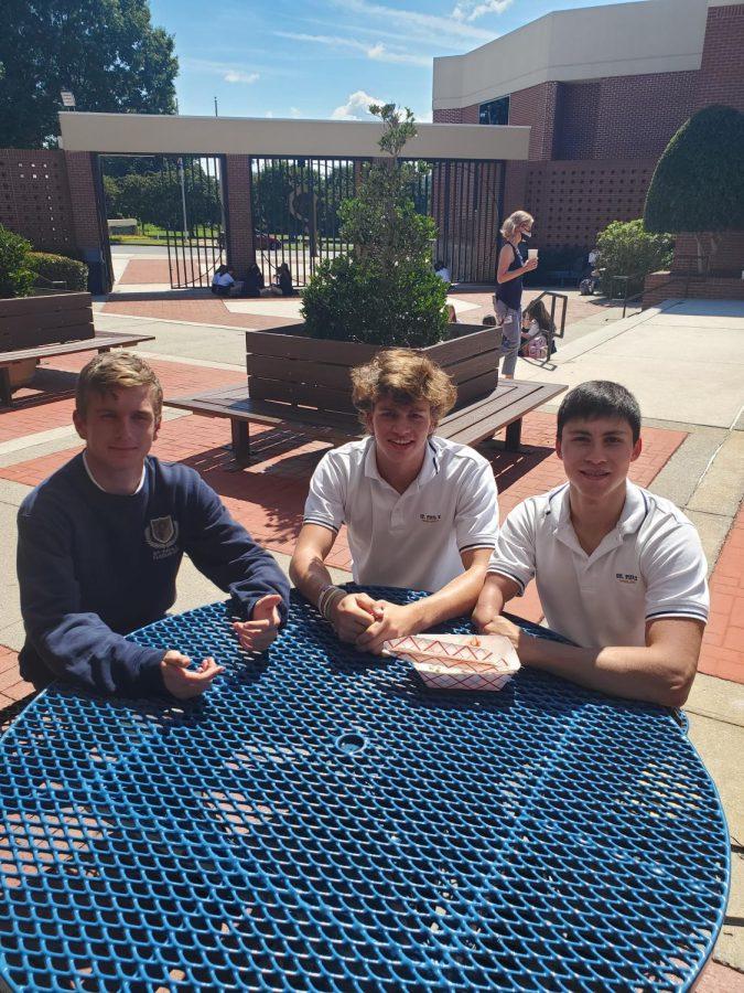 Seniors Sutter Guttery, Joseph McGhee, and Gabe Velaz share a basket of fries during 5th period lunch.