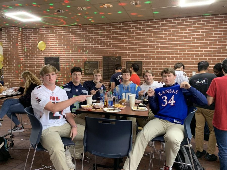 A group of handsome senior boys show off their enthusiasm for sports jersey day during lunch on Tuesday, October 5.
